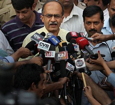 Civil society members Arvind Kejriwal and Prashant Bhushan speak to the media
