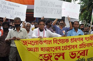 People come out on streets to protest against the arrest of Anna Hazare, in Guwahati on Tuesday