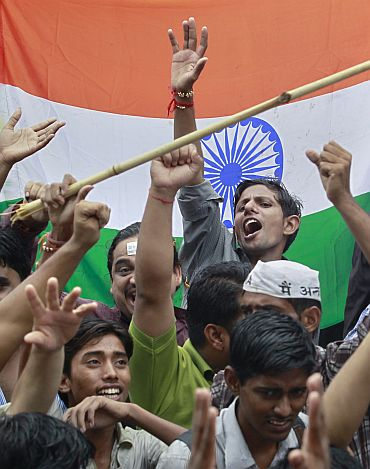 Supporters of Anna Hazare shout anti-government slogans during a protest rally against corruption in New Delhi