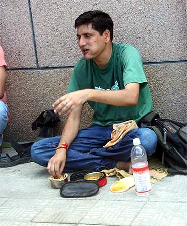 Sunil Rajabhaiyya takes a lunch break at the protest site in front of the Tihar on Wednesday