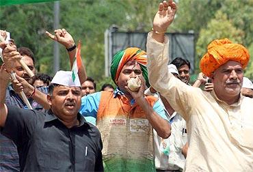 Supporters of activist Anna Hazare outside Tihar Jail