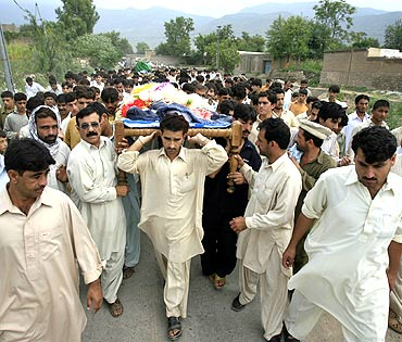 Men carry coffins of victims killed in a suicide bomb attack in Kohat in northwestern Pakistan