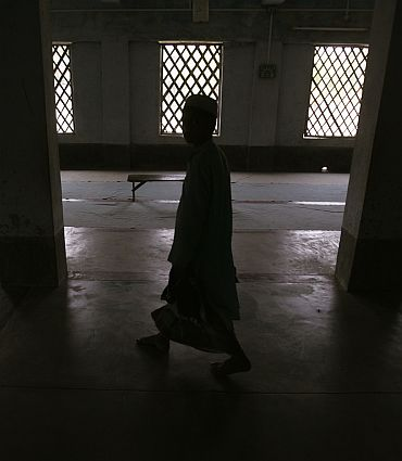 A boy inside a classroom in a madrassa at Nandigram village