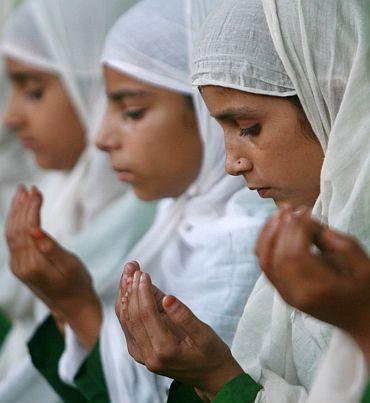 Muslim girls pray in a madrassa in Jammu