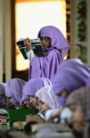 Female madrassa students study the Quran