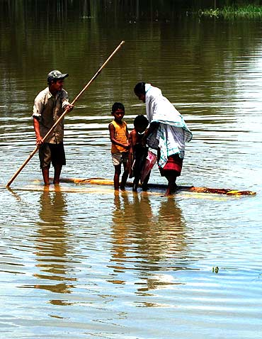 The floods claimed at least five lives in the Assam district as per bodies recovered so far, while thousands have been rendered homeless.