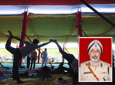 Supporters of Baba Ramdev practice yoga at Ramlila grounds (Inset) BS Brar