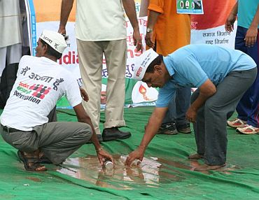 IAC volunteers trying to drain out water