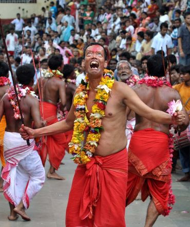 'Deodhas' (temple dancers) dance like men possessed by a spirit