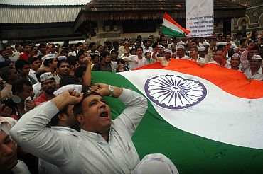 Anna Hazare's supporters protest in Mumbai on Sunday