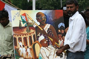 Painter Mohammed Tabrez Alam from Gaya with his paintings at the Ramlila Ground in New Delhi