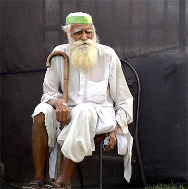 A supporter of Anna Hazare sits on a chair at the Ramlila grounds on Sunday