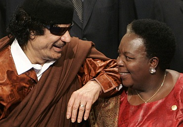 Libya's Colonel Muammar Gaddafi with Pan African Parliament President Gertrude Mongella from Tanzani