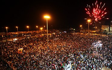 Fireworks explode as people gather near the courthouse in Benghazi