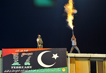 A man lets off fireworks near the courthouse in Benghazi