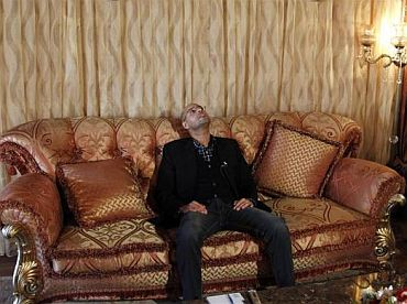 Libyan leader Muammar Gaddafi's most prominent son, Saif al-Islam, pauses during an interview with Reuters in Tripoli March 10