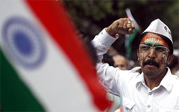 A supporter of Anna Hazare shouts slogans at a rally against corruption in Mumbai