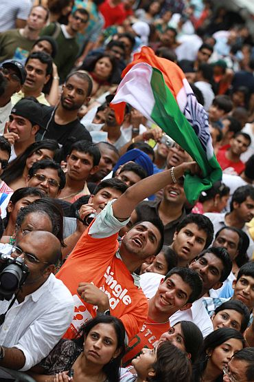 A young Indian American waves the tricolour