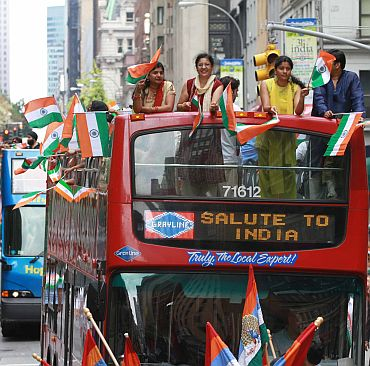 Indian Americans on an open top bus