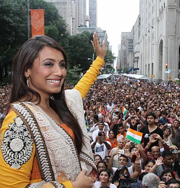 Rani waves to the audience