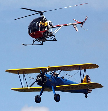 IN PICS: Wing walker plunges 200 feet to his death