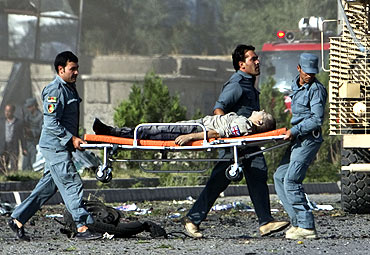 A casualty is carried away from the site the attack in Kabul