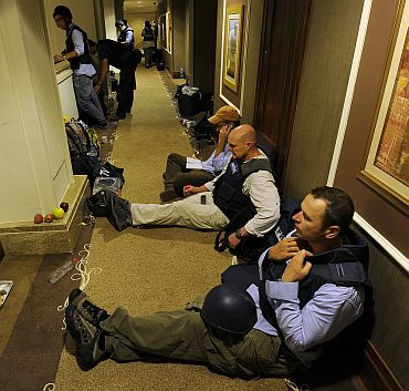 Members of the media gather in the corridors of the Rixos hotel in Tripoli