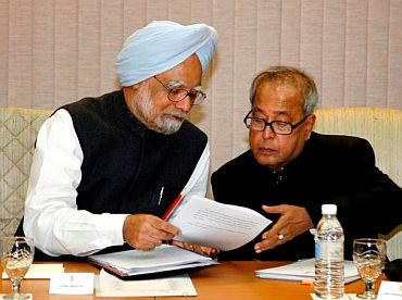 File picture of PM Singh with Finance Minister Pranab Mukherjee