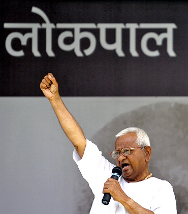 Anna Hazare shouts slogans as he addresses his supporters on the tenth day of his fasting at Ramlila grounds in New Delhi