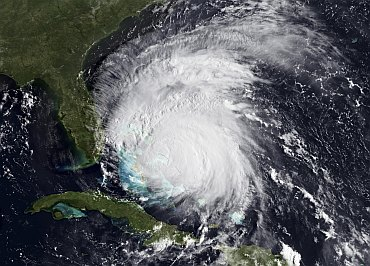Image shows a visible view of Hurricane Irene captured by the GOES-East satellite
