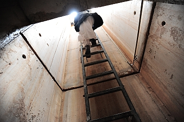 A Libyan man climbs a ladder to exit the extensive underground tunnels running under the summer residence of Libya's leader Muammar Gaddafi's at Cyrene near the Beydah