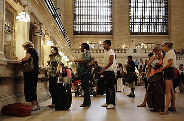 Travellers wait in line for Metro North tickets at New York's Grand Central Station
