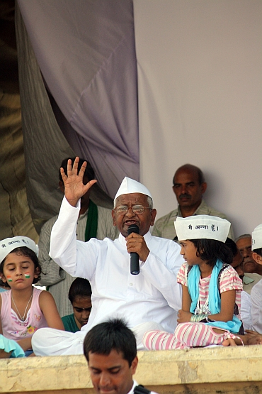 Hazare waves to his supporters at Ramlila Maidan