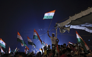 Hazare's suppoters wave the tricolour