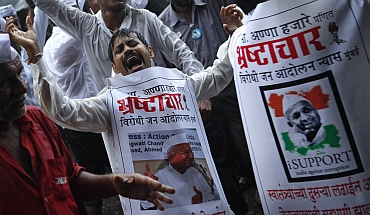Supporters of Hazare dance in Mumbai on Sunday