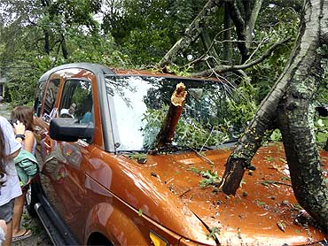 A tree lies on a vehicle in West Hempstead after being blown down by the winds of Hurricane Irene