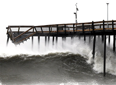 Waves break along the pier which was damaged during Hurricane Irene, in Ocean City, Maryland