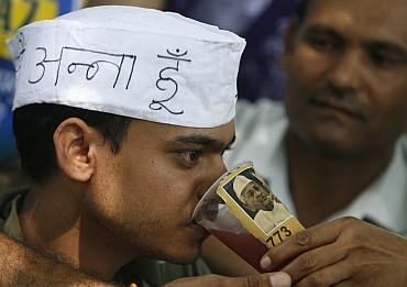 Ravi Verma, a university student, who fasted alongside Hazare to show his support, takes a drink to end his fast in Chandigarh