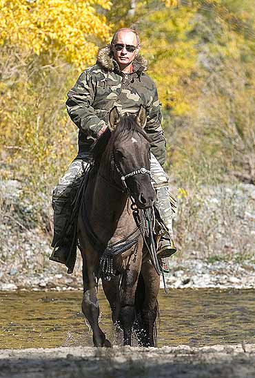 Putin rides a horse as he takes part in an expedition to Ubsunur Hollow Biosphere Preserve to inspect the snow leopard's habitat in Tyva Republic in the Siberian Federal District