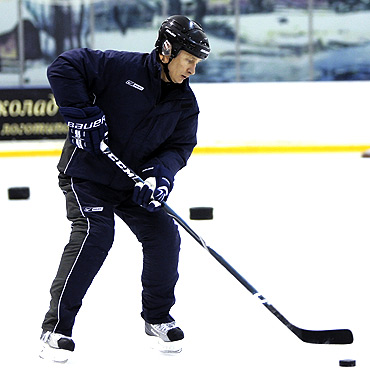 Putin attends an ice hockey training session in Moscow