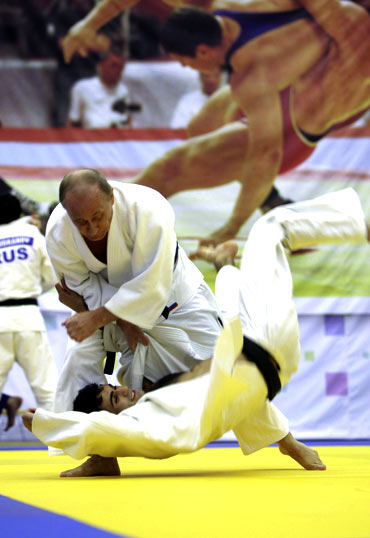 Putin takes part in a judo training session at the Moscow sports complex in St. Petersburg