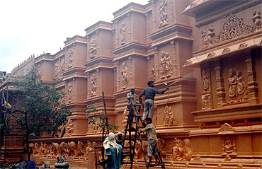 Artisans give a final touch to the pandal at Tilak Nagar