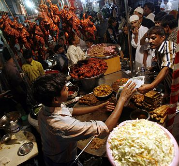 Muslims buy food from a roadside stall in the old quarters of Mumbai
