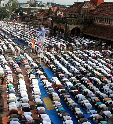 Muslims offering prayers outside the Bandra railway station, Mumbai