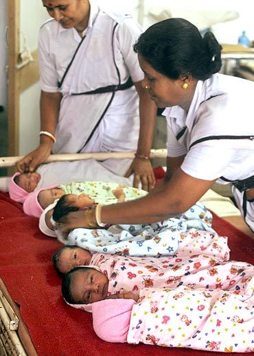 Nurses take care of newly born babies inside a ward of a maternity hospital in Agartala.