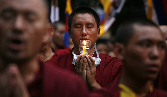 Tibetan monks pray during the congregation
