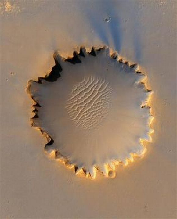 Mars' Victoria Crater at Meridiani Planum in an image taken by NASA's High Resolution Imaging Science Experiment camera and released October 6, 2006.