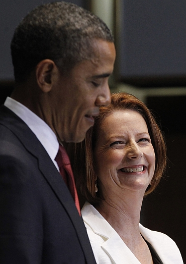 US President Barack Obama and Australian Prime Minister Julia Gillard participate in a press conference at Parliament House in Canberra, Australia