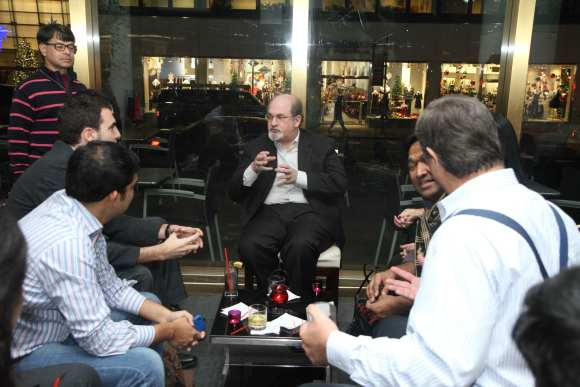 Salman Rushdie interacts with guests at Vermillion restaurant