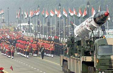 Soldiers roll out the Agni missile during rehearsal for the Republic Day parade in New Delhi